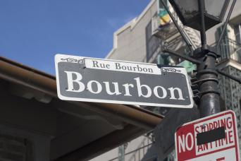 Bourbon Street sign in New Orleans seen on walking tour