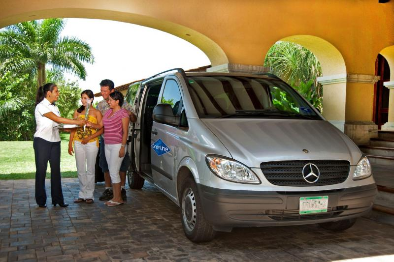 Airport transfer vehicle at hotel from Cancun International Airport