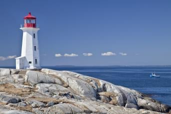 View of lighthouse at sea on Peggy's Cove tour