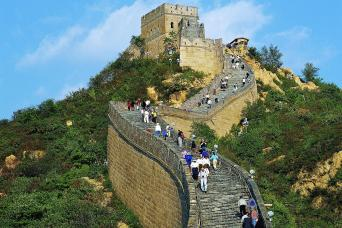 People climbing the Great Wall of China on Beijing tour